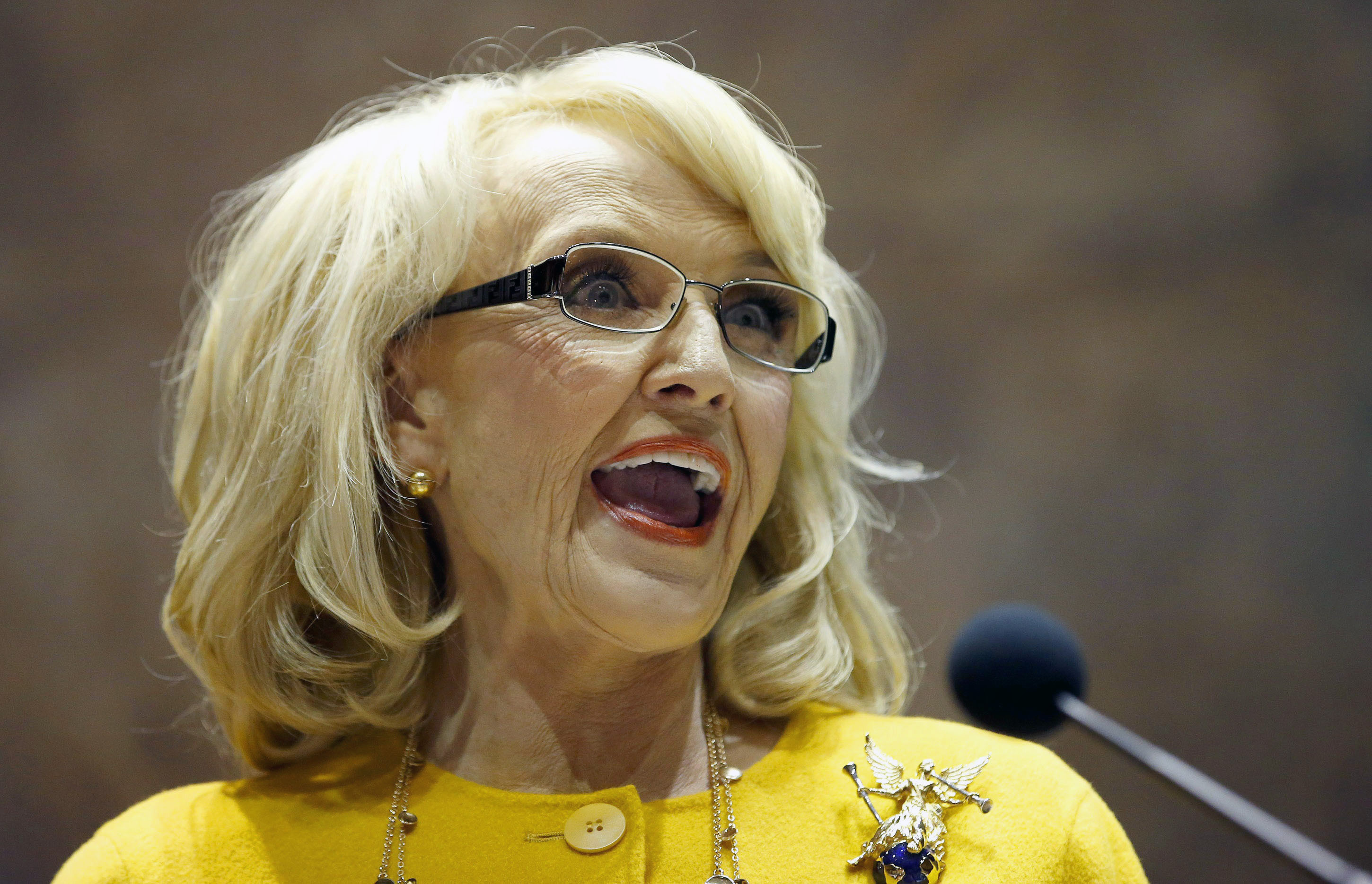 In this Jan. 13, 2014 file photo, Arizona Gov. Jan Brewer speaks during her State of the State address at the Arizona Capitol in Phoenix.