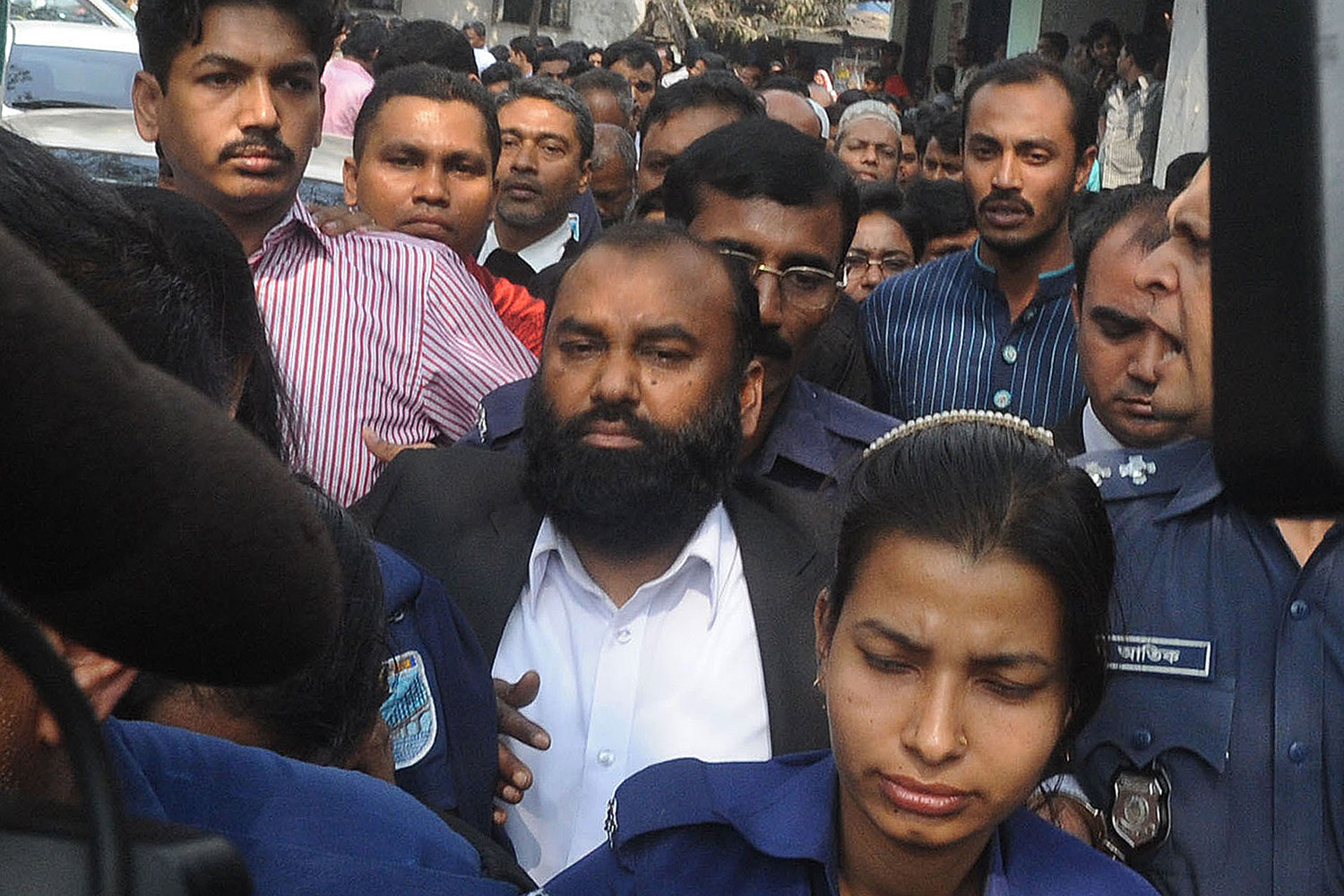 The owner of Tazreen Fashions, Delwar Hossain (C) is escorted to court in Dhaka on Feb. 9, 2014.