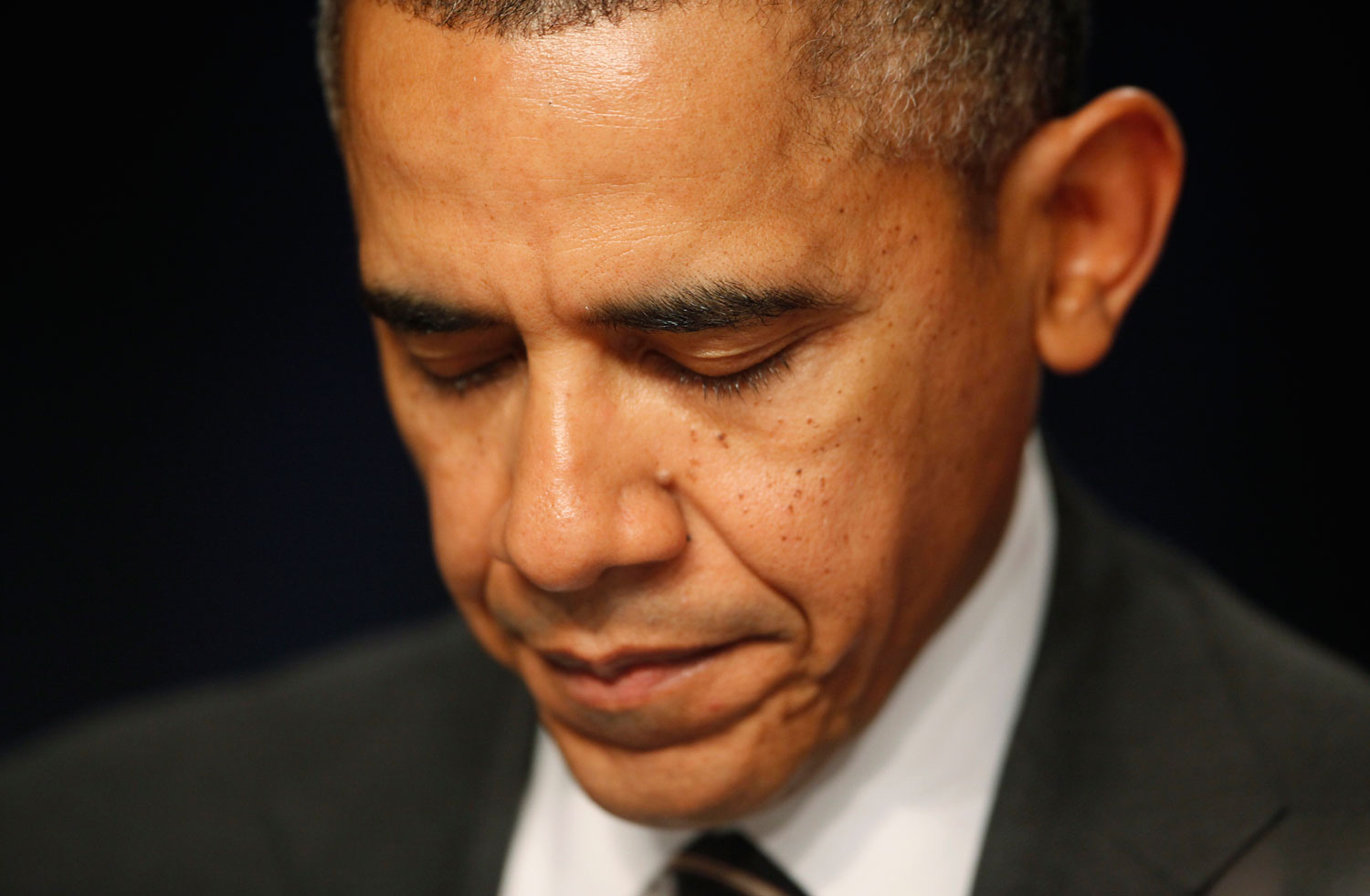 President Barack Obama closes his eyes as a prayer is offered at the National Prayer Breakfast in Washington, Feb. 6, 2014.