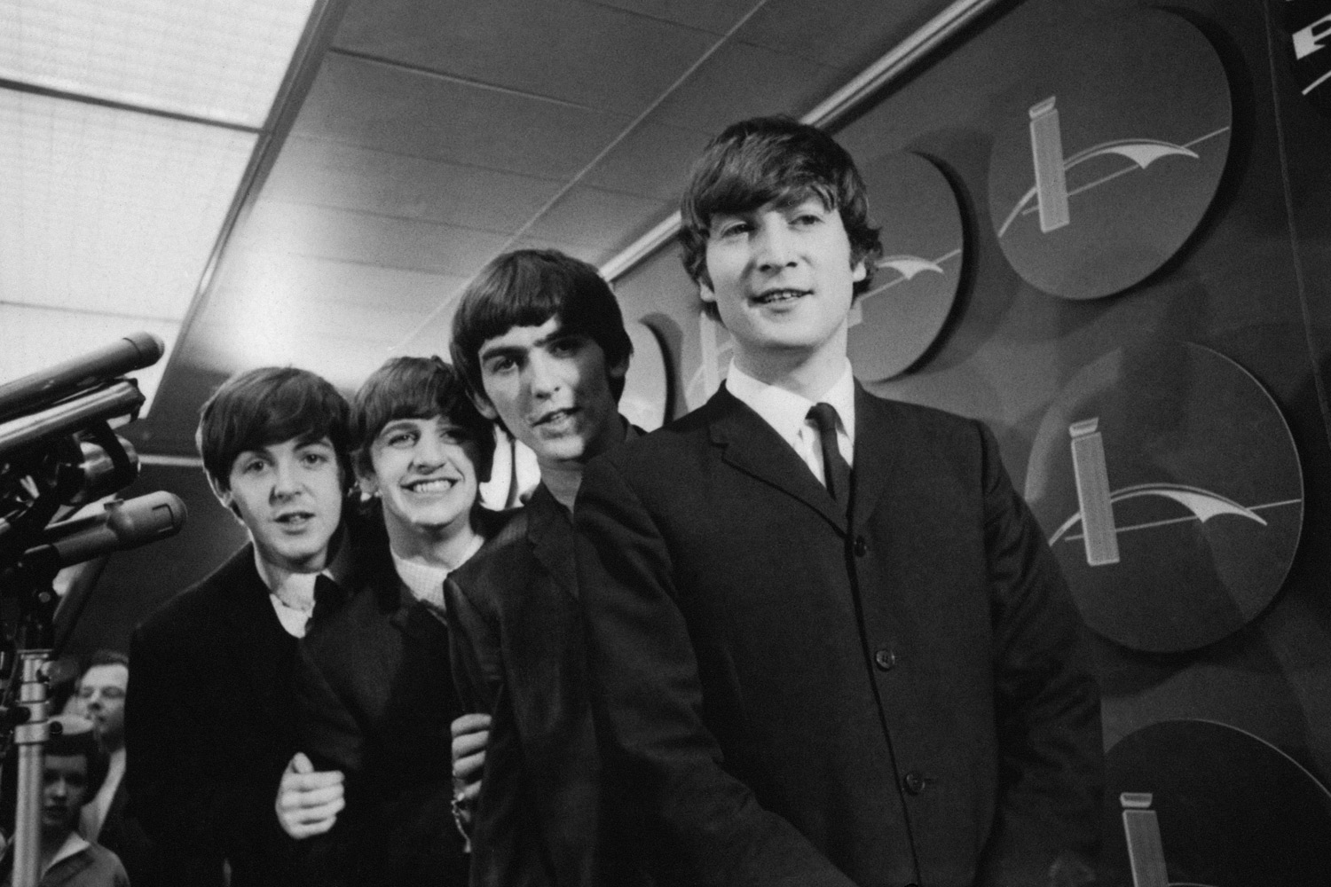 The Beatles after arriving at John F. Kennedy International Airport, February 7, 1964. From left: Paul McCartney, Ringo Starr, George Harrison and John Lennon