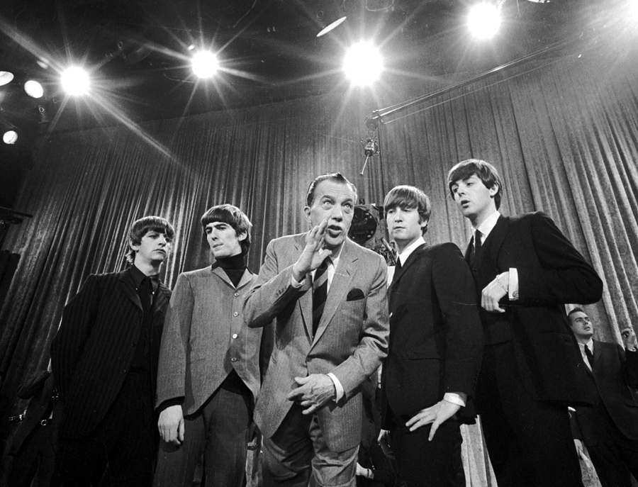 Ed Sullivan, center, stands with The Beatles during a rehearsal for the British group's first American appearance, on the  Ed Sullivan Show,  in New York on Feb. 9, 1964.