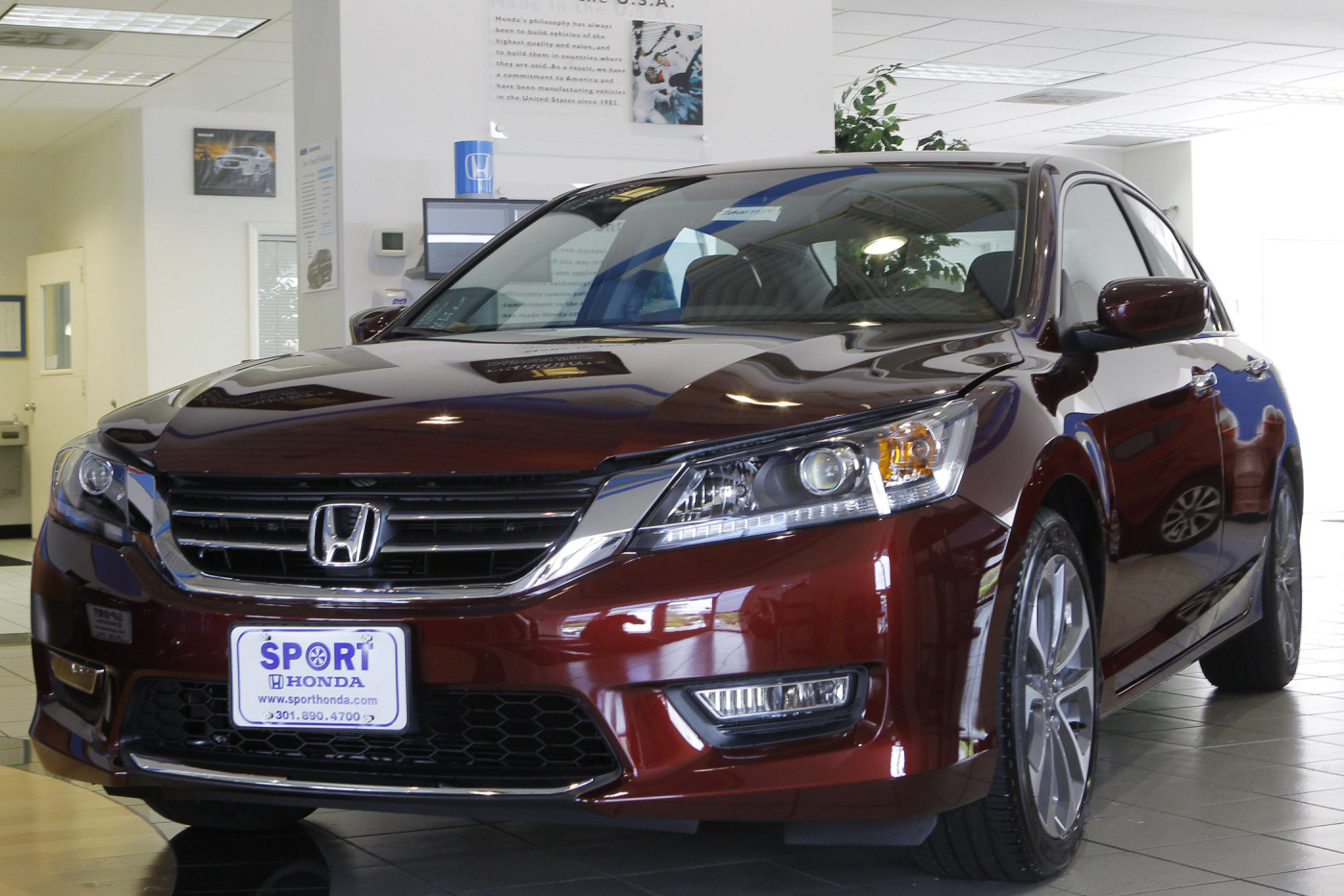 A new 2013 Honda Accord is shown on the sales floor at Sport Honda in Silver Spring, Maryland Sept. 17, 2012.