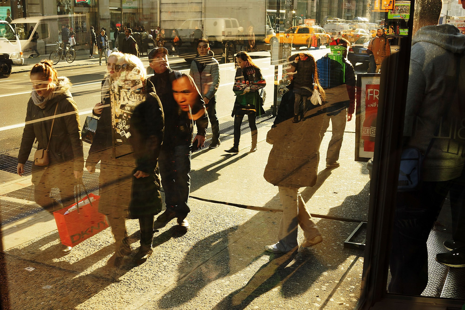 People walk along Broadway on December 2, 2013 in New York City.