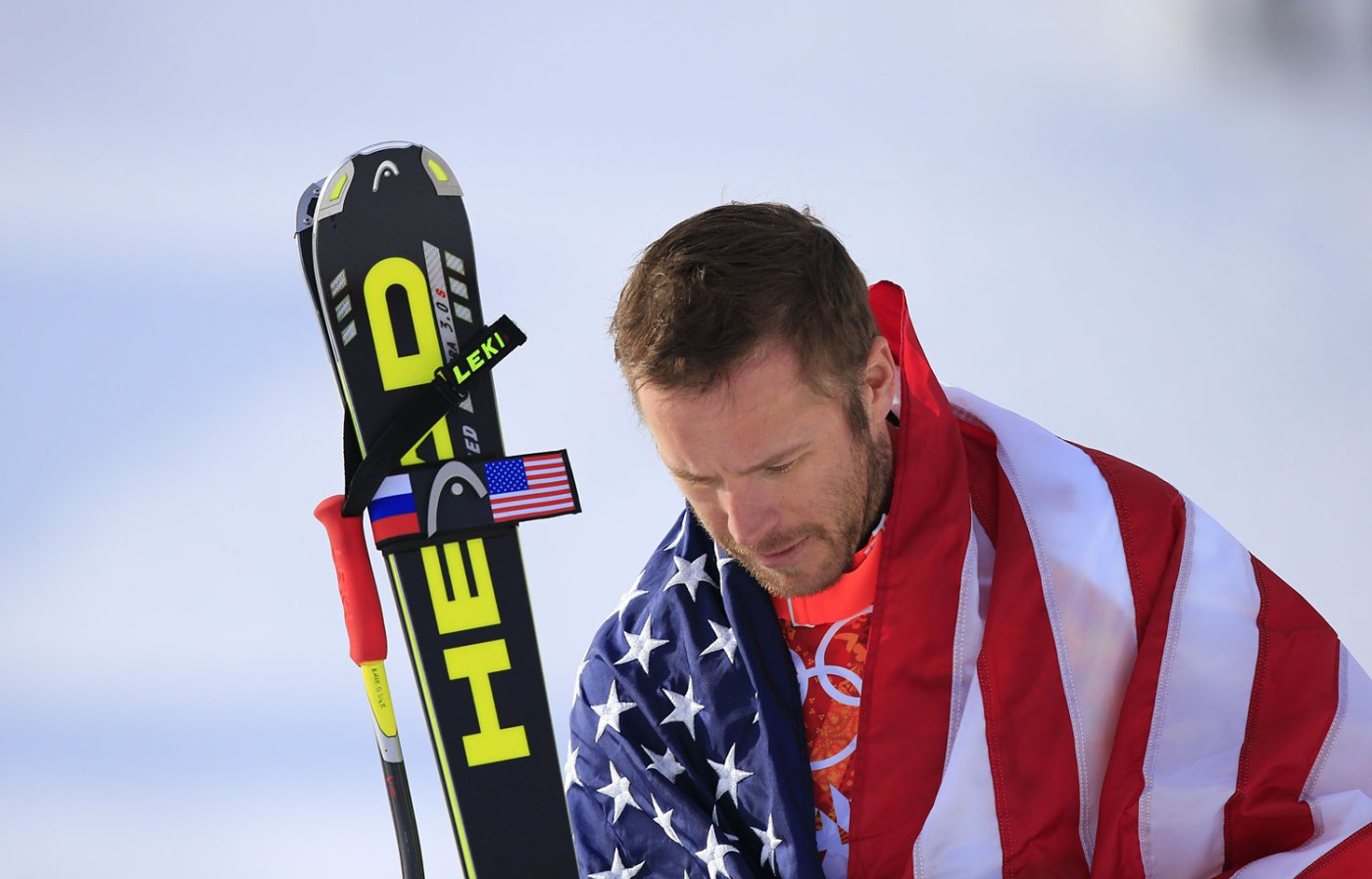 Bode Miller arrives on the podium during the Men's Alpine Skiing Super-G Flower Ceremony.