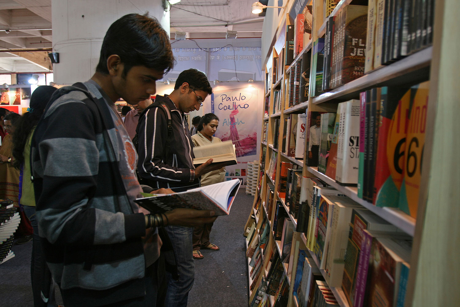 Readers browse through Penguin books in New Delhi. As of today, Wendy Doniger's won't be among them