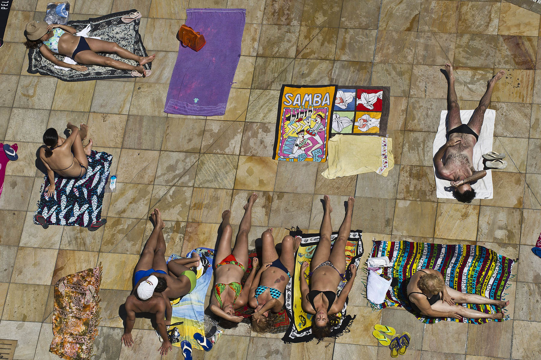 People lounge poolside at the SESC Belenzinho club in Sao Paulo, Brazil on Jan. 31, 2014.
