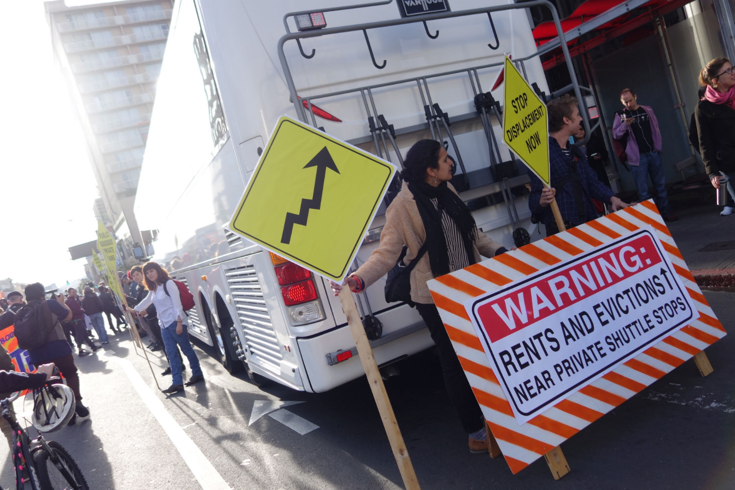 Protestors blockade private shuttle carrying tech industry employees from their homes in San Francisco to their jobs at the company's campus in Silicon Valley.