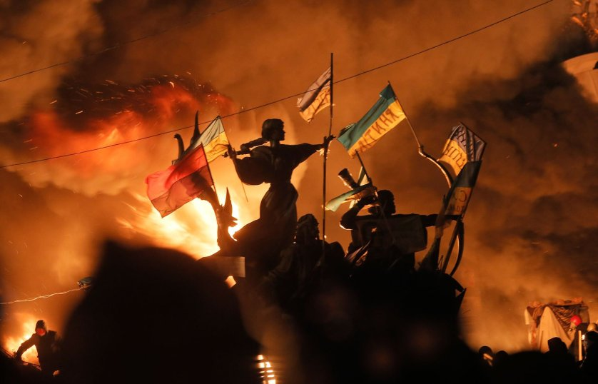 Monuments to Kiev's founders burn as anti-government protesters clash with riot police in Kiev's Independence Square, Feb. 18, 2014.