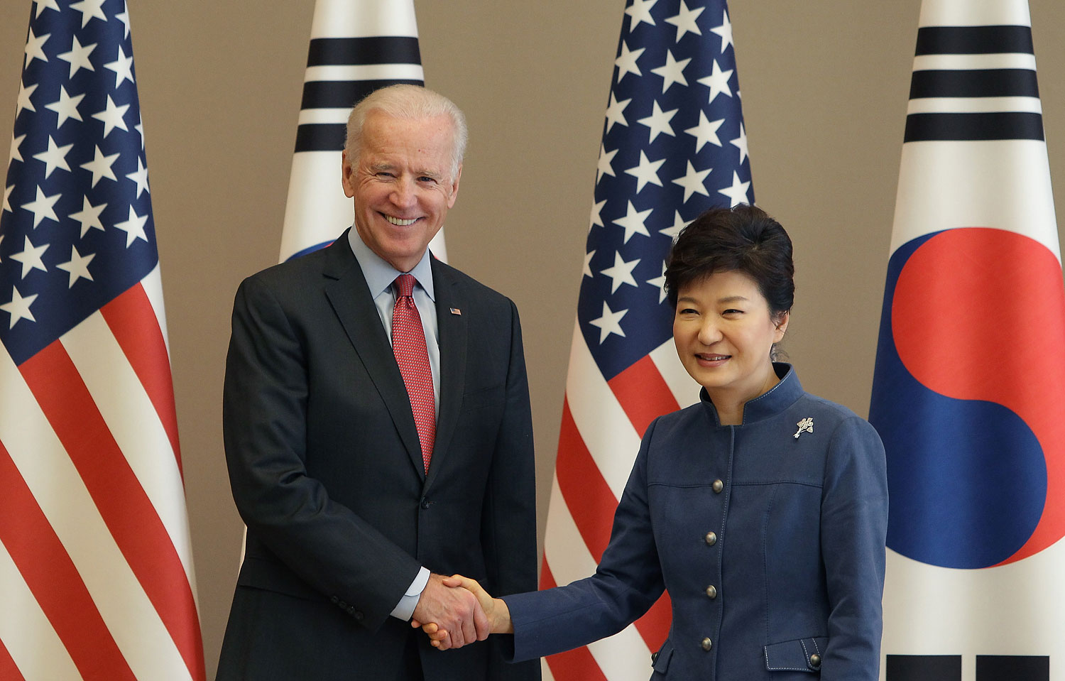 U.S. Vice President Joe Biden shakes hands with South Korean President Park Geun-Hye, right, during their meeting at presidentisl house on Dec. 6, 2013 in Seoul, South Korea to discuss, among other things, the Trans-Pacific Partnership.