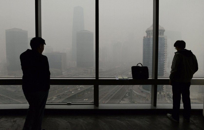 People look at an area of central Beijing blanketed in smog on Feb. 24, 2014.