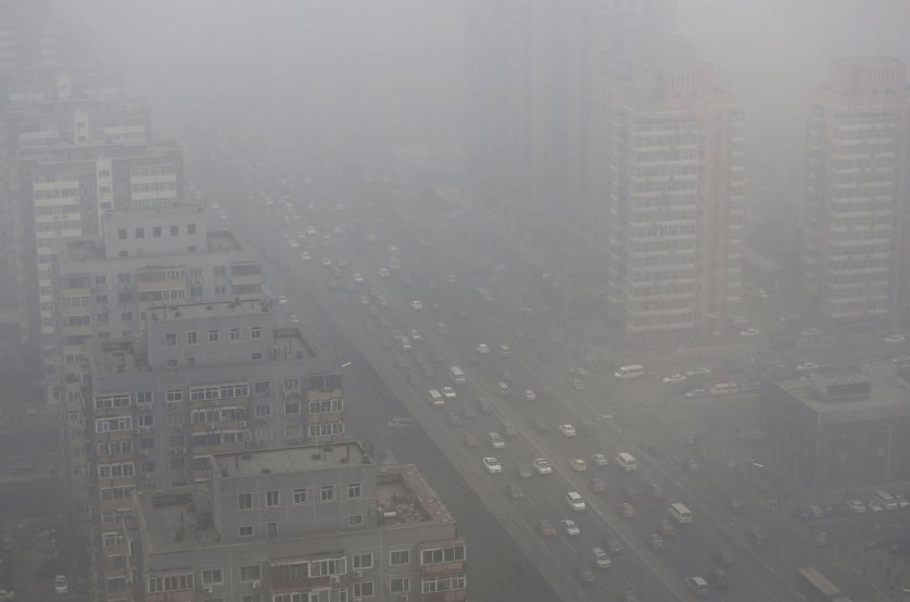 Cars drive on the Three Ring Road amid the heavy haze in Beijing, Feb. 26, 2014.