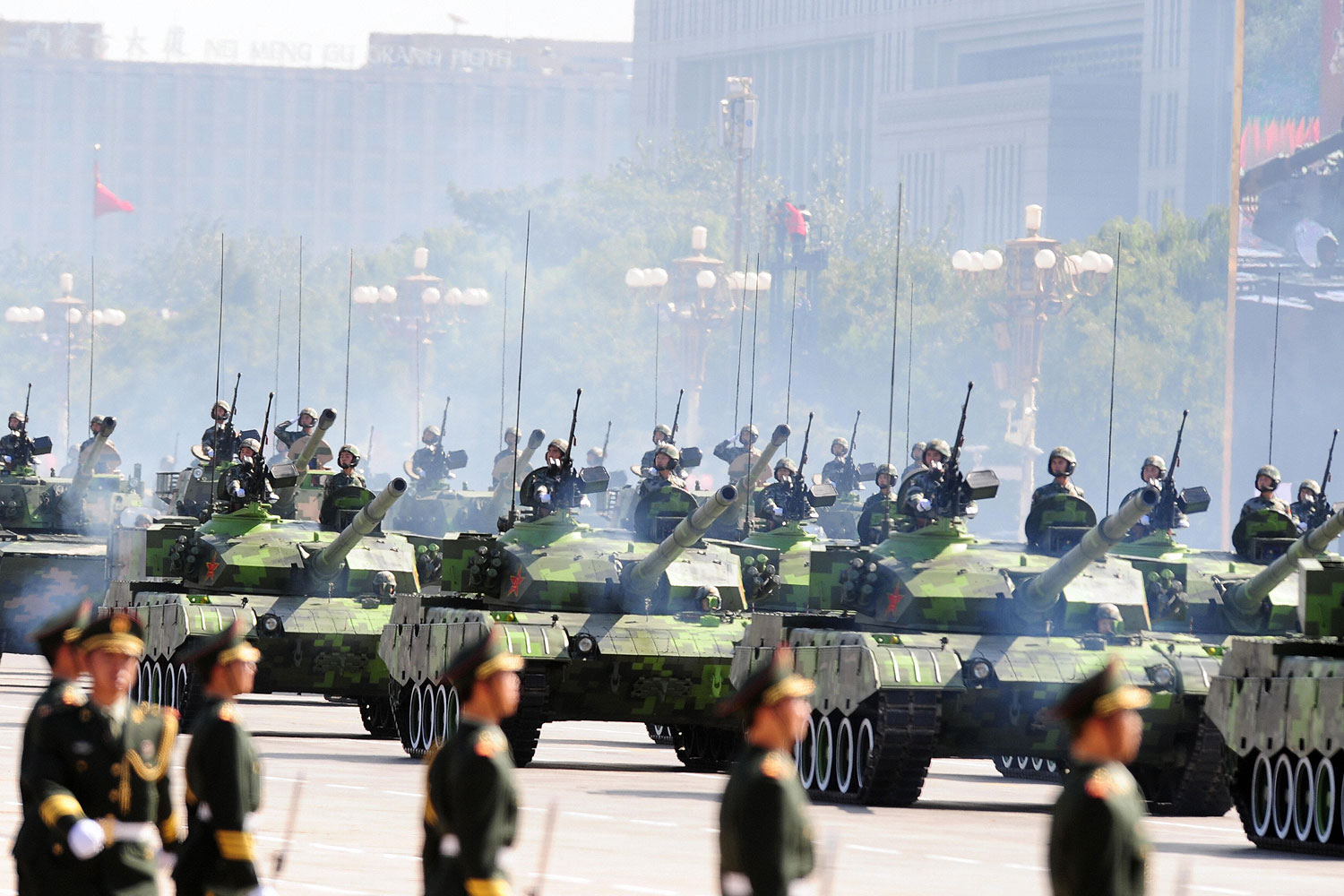 Chinese People's Liberation Army (PLA) tanks rumble past Tiananmen Square during the National Day parade in Beijing