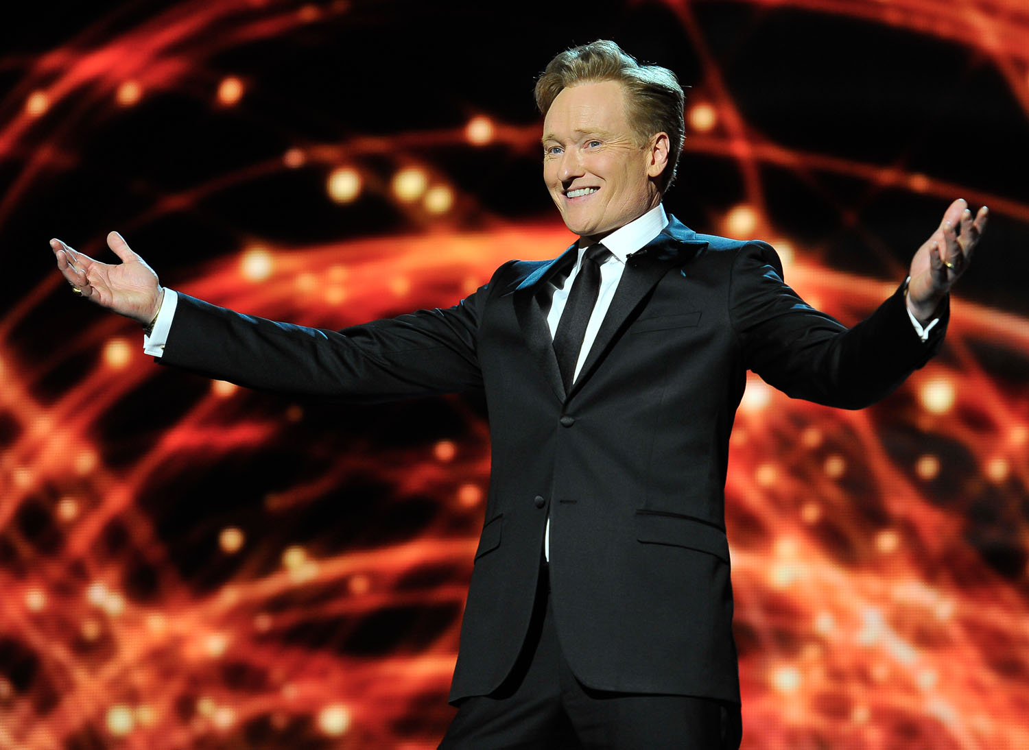 Conan O'Brien presents at the 2014 Breakthrough Prizes Awarded in Fundamental Physics and Life Sciences Ceremony at NASA Ames Research Center on December 12, 2013 in Mountain View, California.