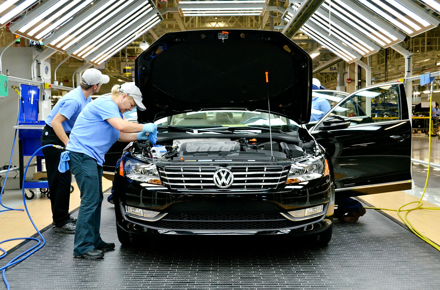 Line inspection workers check out a Volkswagen AG 2012 Passat at the company's factory in Chattanooga, Tennessee, June 1, 2011.