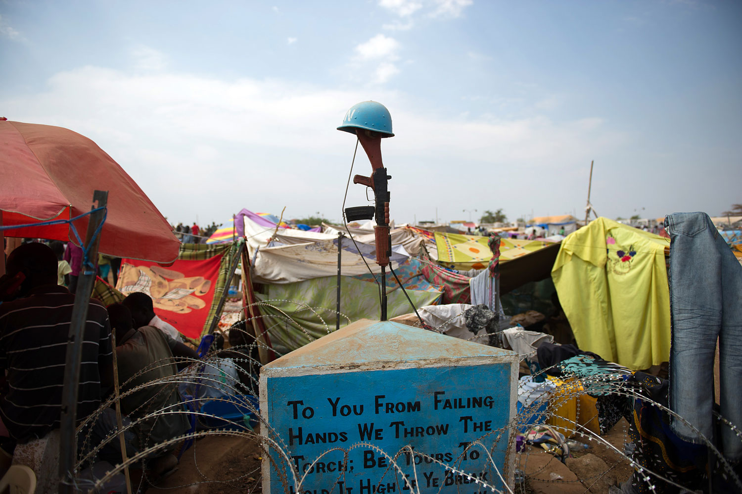 A monument for fallen peacekeepers stands amidst makeshift tents in a spontaneous camp for internally displaced persons at the United Nations Mission to South Sudan base in Juba,  on Jan. 9, 2014.