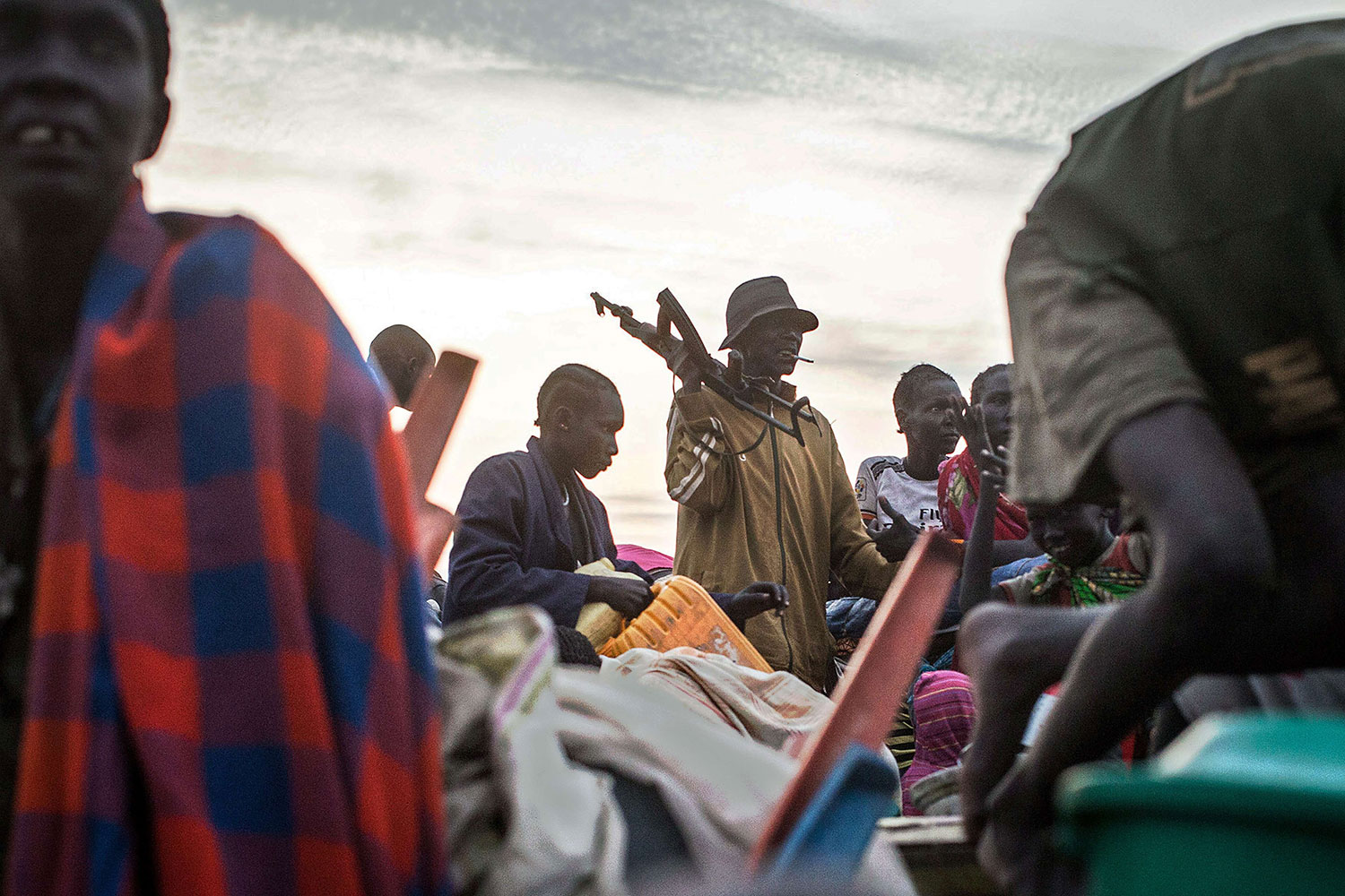 People arrive to Minkammen, South Sudan on Jan. 9, 2014 having crossed over the Nile River by night.