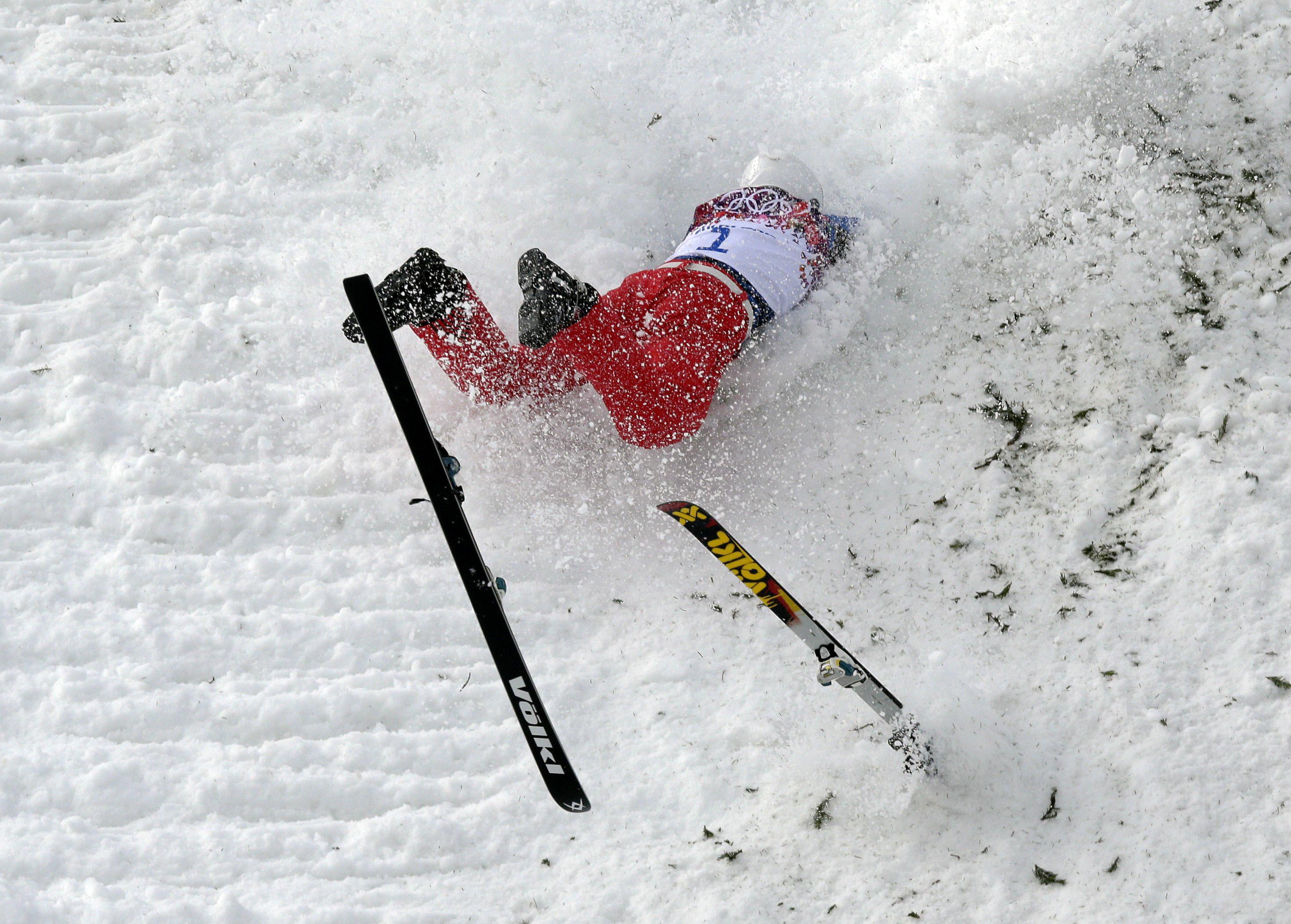China's Liu Zhongqing crashes during freestyle skiing aerials training at the Rosa Khutor Extreme Park.