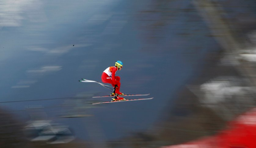 Denmark's Christoffer Faarup goes airborne during the downhill run of the men's alpine skiing super combined training session.