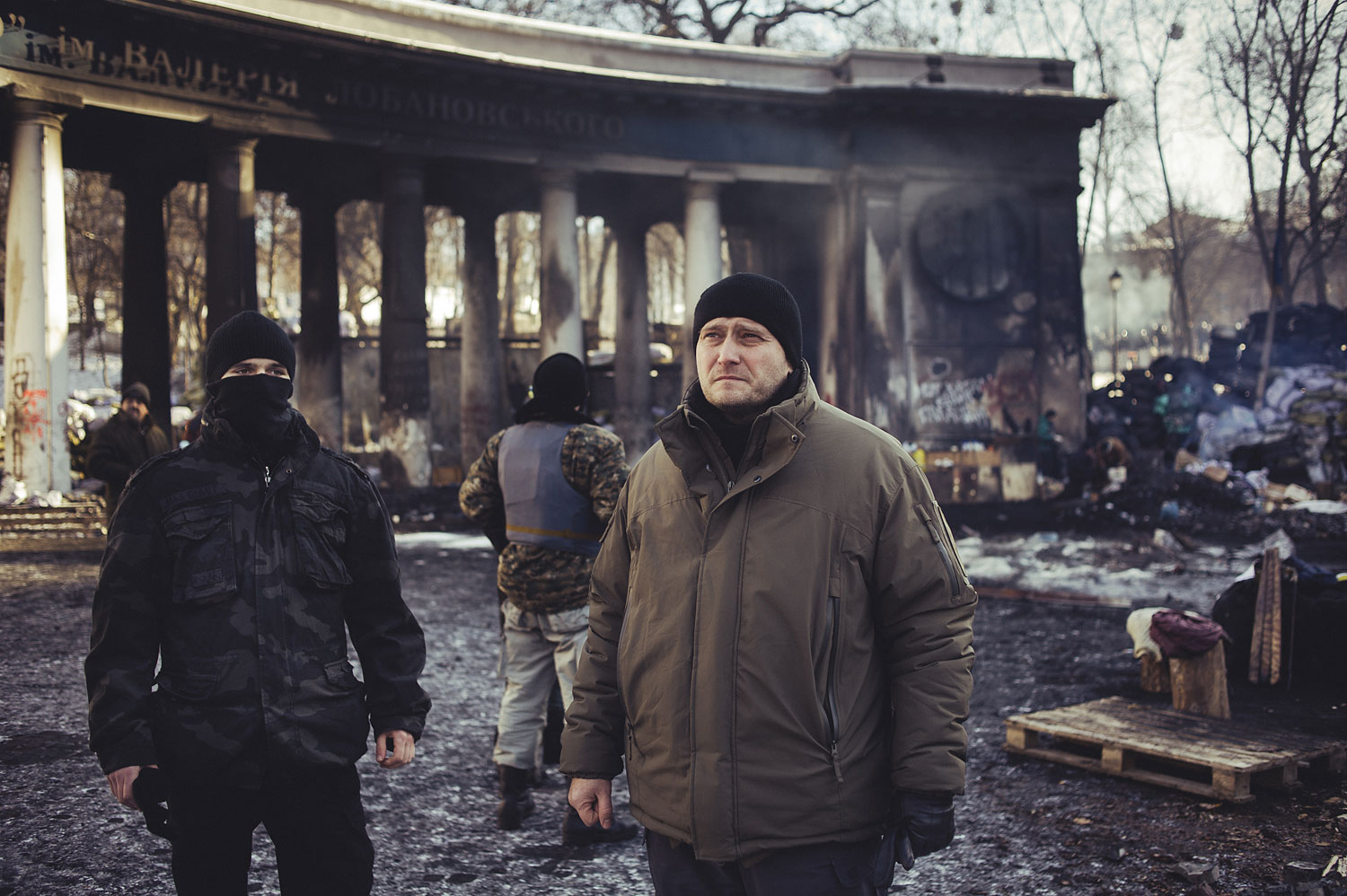Dmitro Yarosh, the leader of Pravy Sektor, a coalition of ultra-nationalist groups in Ukraine, stands with some of his fighters at the scene of the worst clashes last month between the group's fighters and police in Kiev.