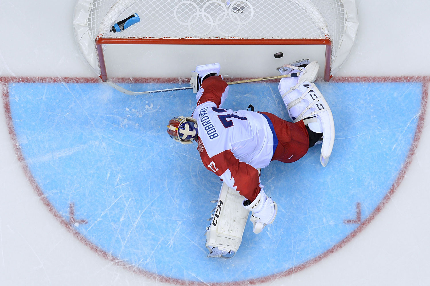 Russia's goalkeeper Sergei Bobrovski fails to stop a penalty during the Men's Ice Hockey Group A match USA vs Russia at the Bolshoy Ice Dome during the Sochi Winter Olympics on February 15, 2014 in Sochi.