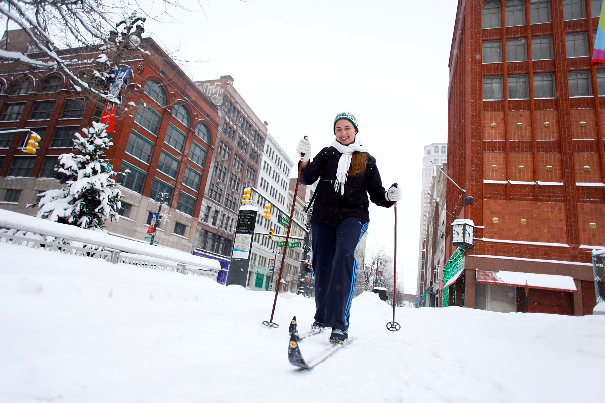 Alison Mueller skies to work through several inches of snow along Woodward Avenue as the area deals with record breaking freezing weather January 6, 2014 in Detroit, Michigan