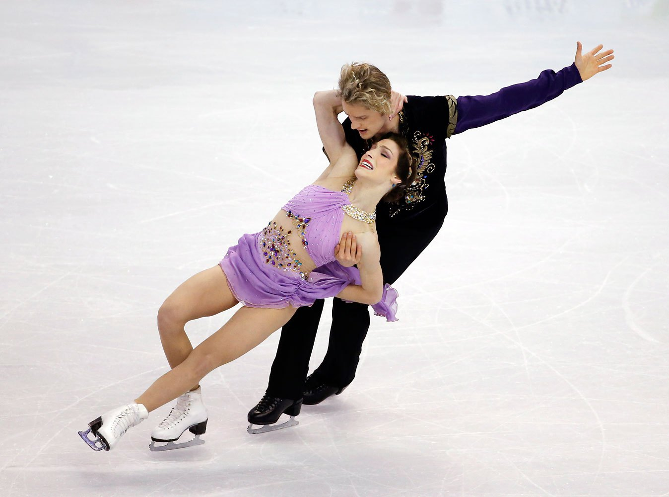 A month earlier, Davis and White skated the same program during the U.S. Figure Skating Championships in Boston, except in lavender. They used the same outfits to win the U.S.'s first gold in ice dance in Sochi, although their dressmakers also created an aqua version.