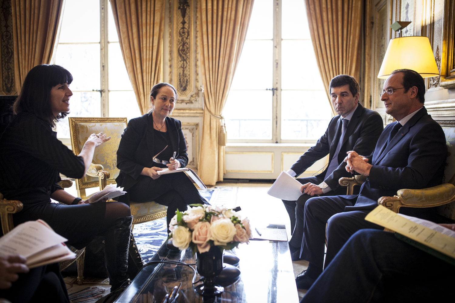 TIME's Catherine Mayer, left, and Vivienne Walt talk to François Hollande in the Élysée Palace, Paris.