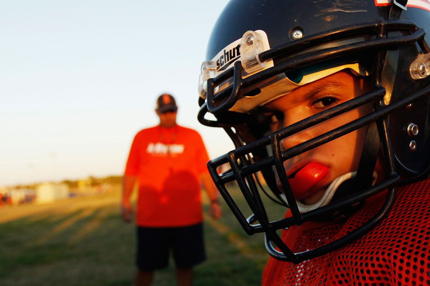 A youngster chews on his mouthguard during the filming of the television docu-series  Friday Night Tykes  in San Antonio, Texas.