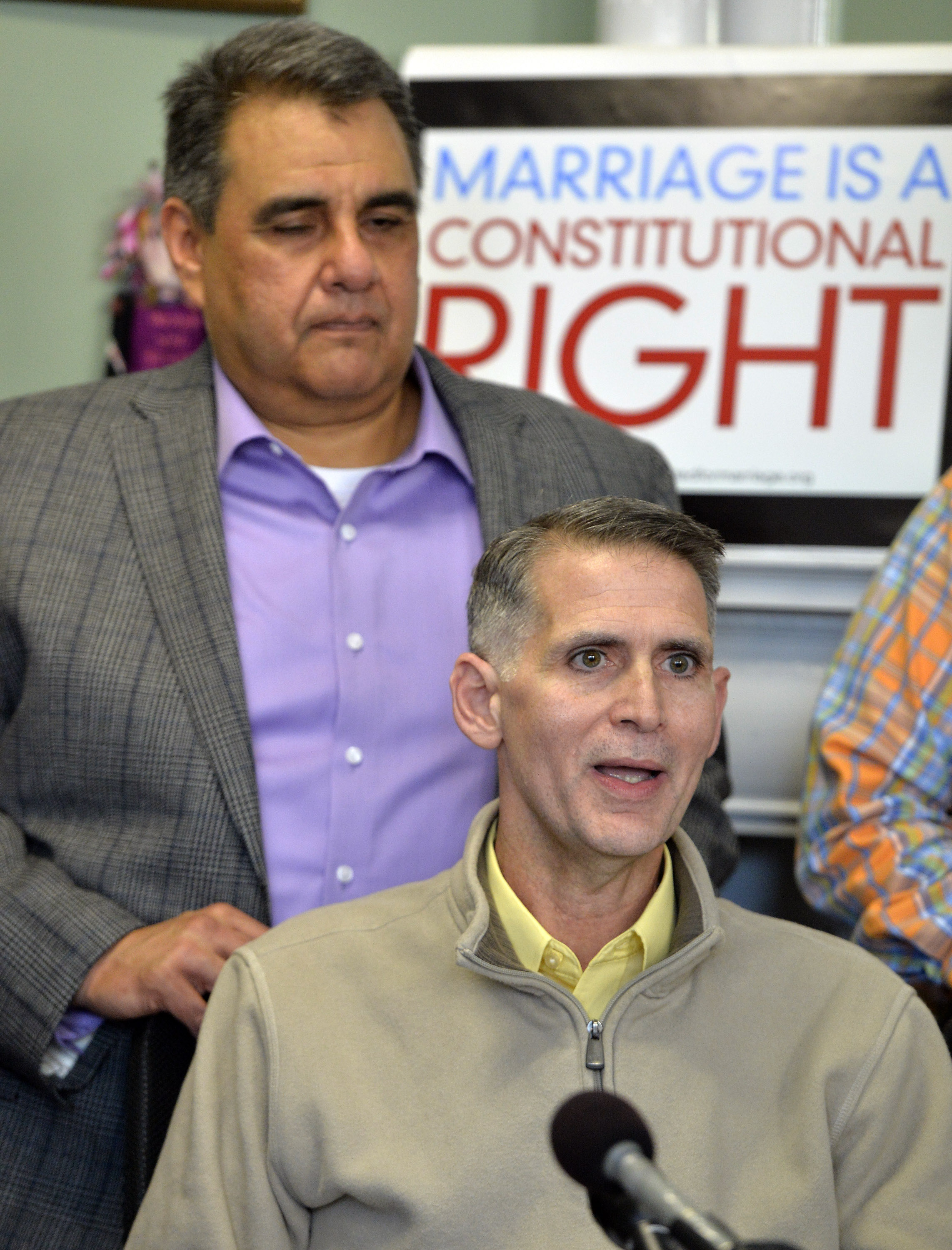 Greg Bourke, front, and his partner Michael Deleon speak to reporters following the announcement from U.S. District Judge John G. Heyburn striking down Kentucky's same-sex marriage ban Wednesday, Feb. 12, 2014, in Louisville, Ky.