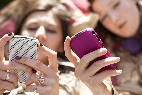 Texting while having a real-life conversation ranks as one of the top annoying tech habits.