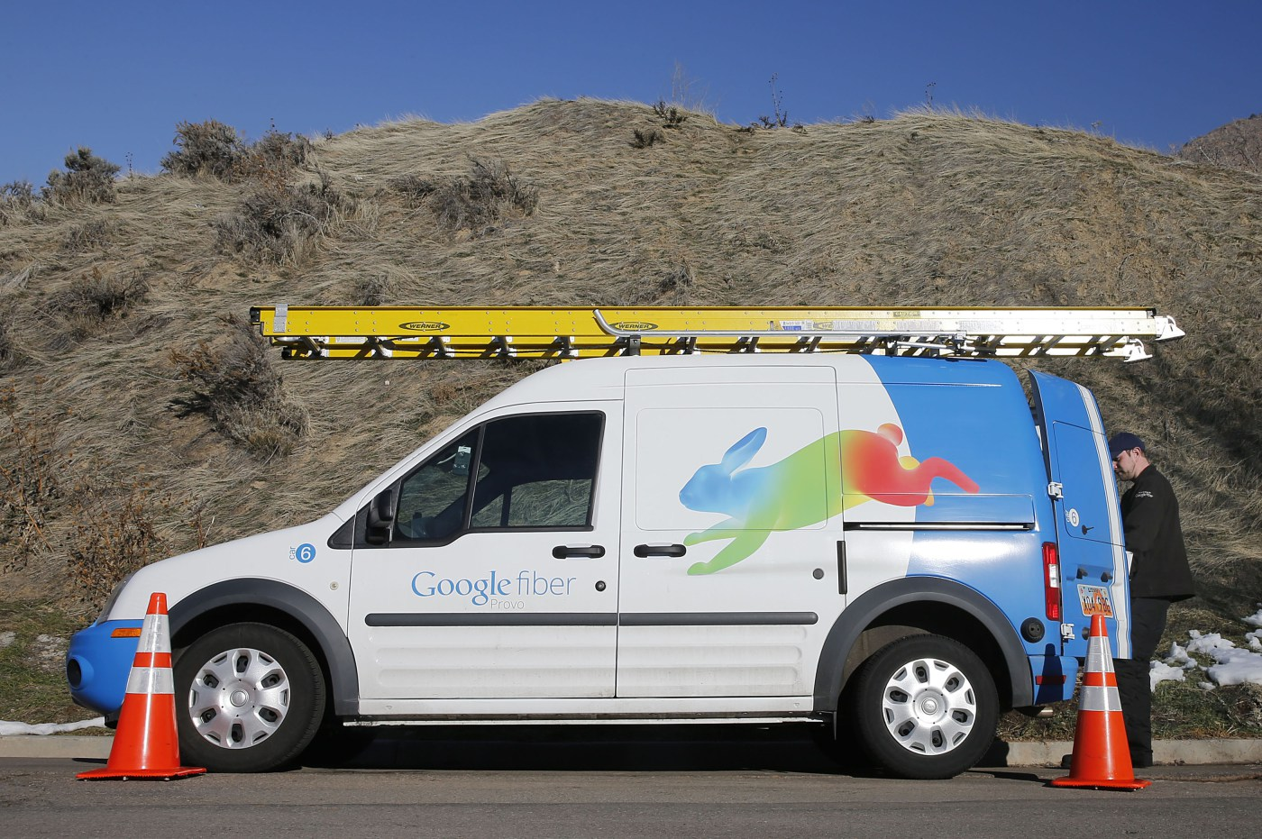 A Google Fiber technician gets supplies out of his truck to install Google Fiber in a residential home in Provo, Utah, January 2, 2014. Provo is one of three cities Google is currently building gigabit internet and television service for business and residential use.