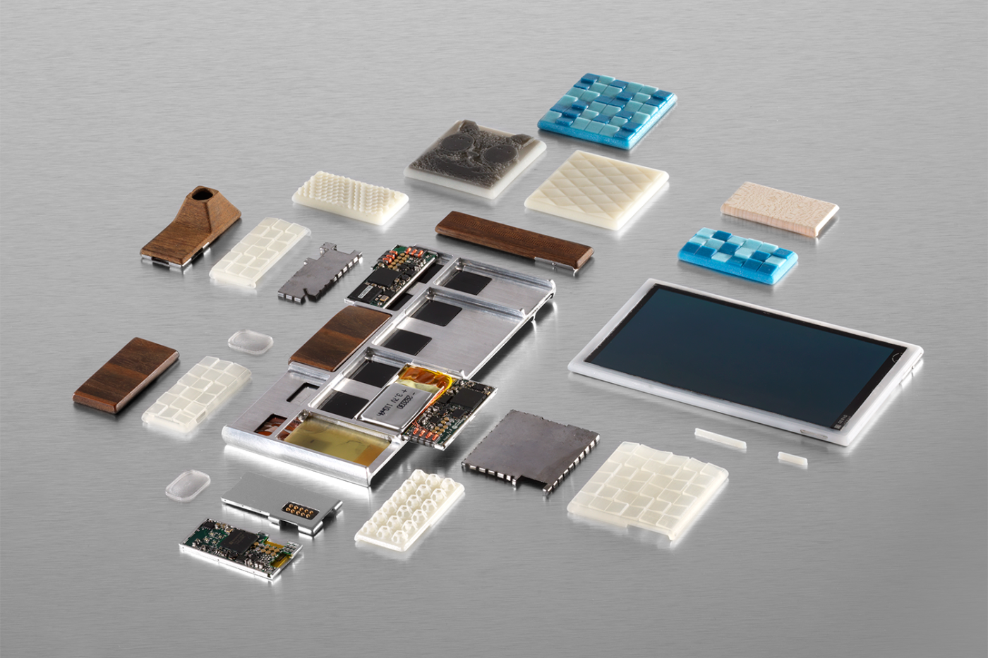 Parts of a functional prototype of a Project Ara phone -- still a work in progress -- including the endoskeleton frame, the screen, electrical components and custom 3D-printed module enclosures.
