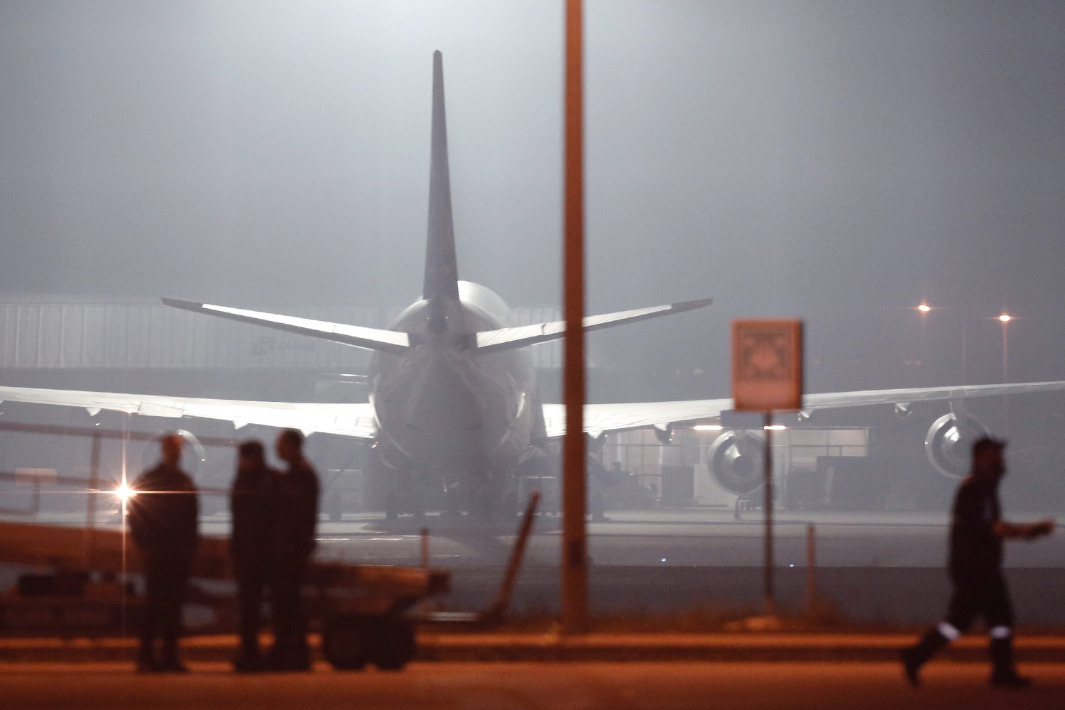 Turkish police forces arrive at the scene after hijacked airplane of a Turkish company Pegasus Airlines was landed at Sabiha Gokcen Airport in Istanbul, on Feb. 7, 2014.