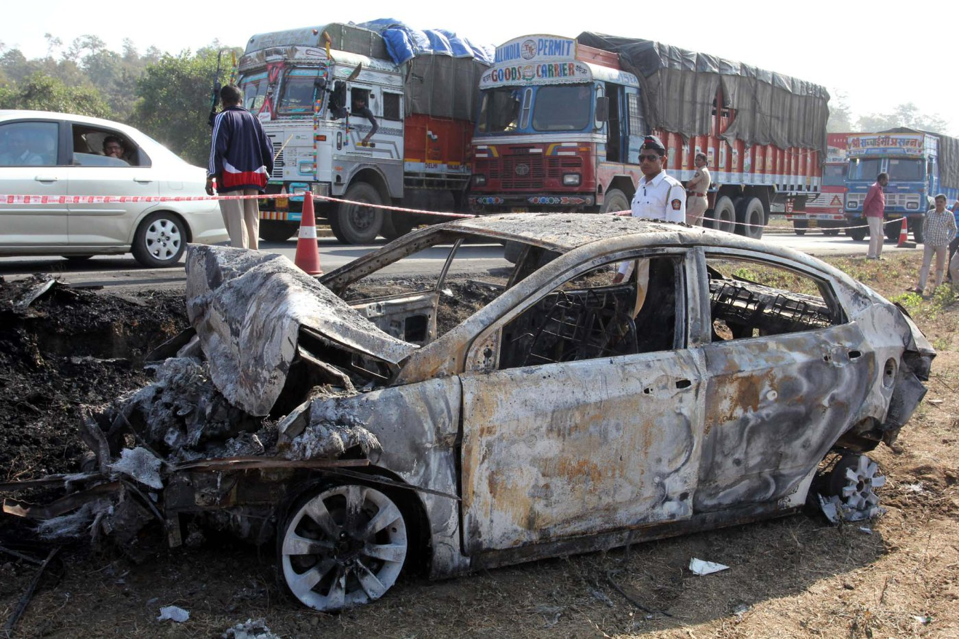 A charred car stands at the accident spot on the Mumbai-Ahmedabad highway near Manor police station following the collision between a tanker containing diesel and a luxury bus on Jan. 29, 2014, in Mumbai, India.