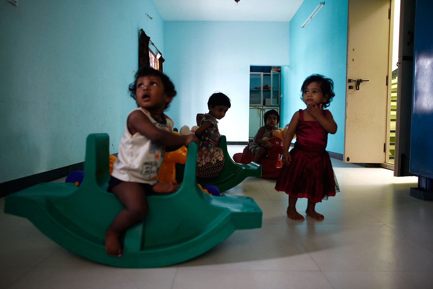 Baby girls play inside the Life Line Trust orphanage in Salem in the southern Indian state of Tamil Nadu June 20, 2013