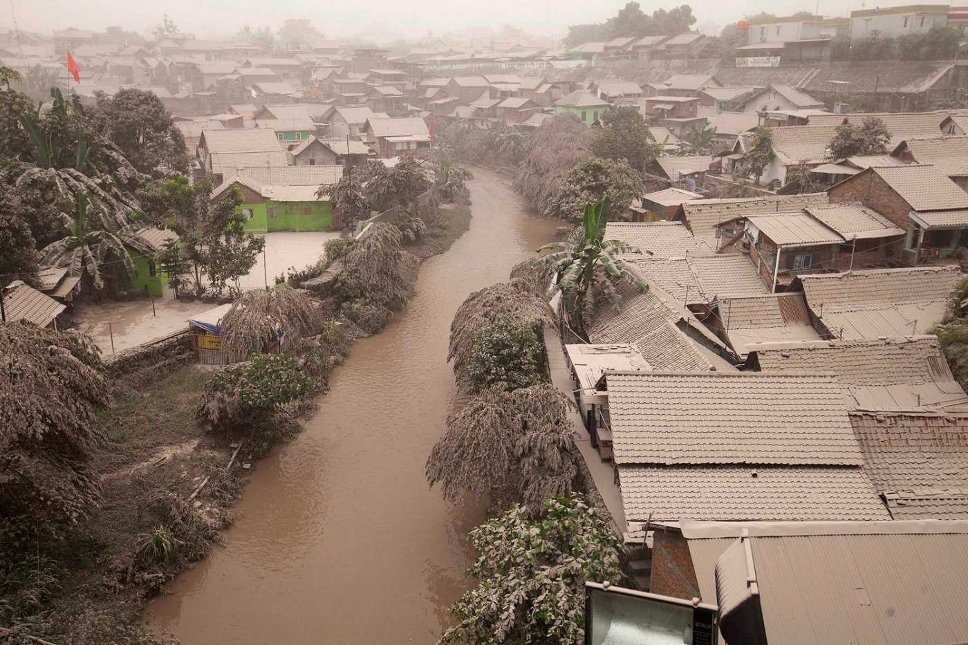 A housing complex is seen covered with ash from Mount Kelud, in Yogyakarta, Feb. 14, 2014.