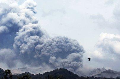 Mount Kelud erupts, as seen from Anyar village in Blitar East Java, Indonesia, Feb. 14, 2014.