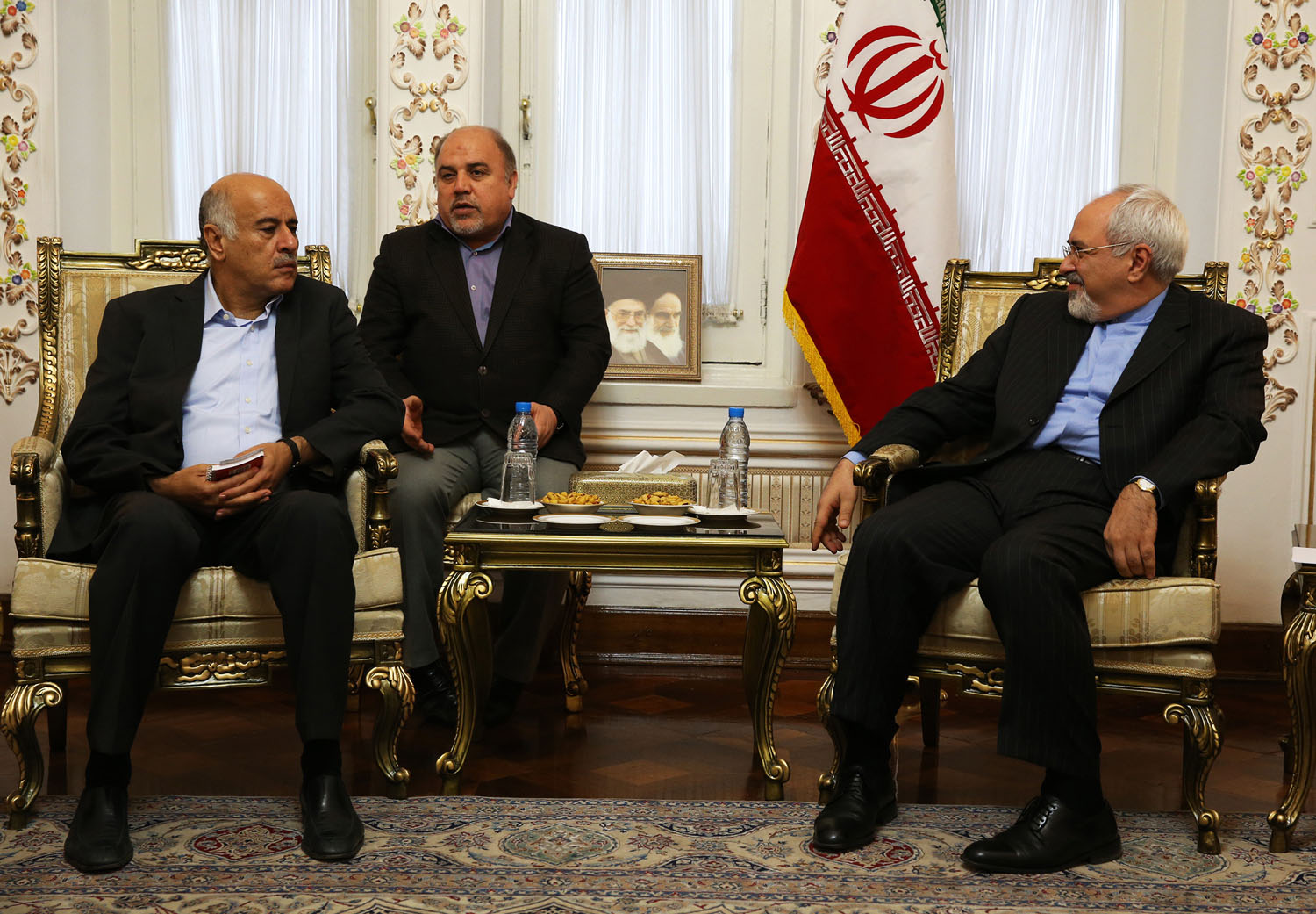 Jibril Rajoub, a senior official in the Palestinian Authority, left, meets with Iranian Foreign Minister Mohammad Javad Zarif in Tehran on Jan. 28, 2014