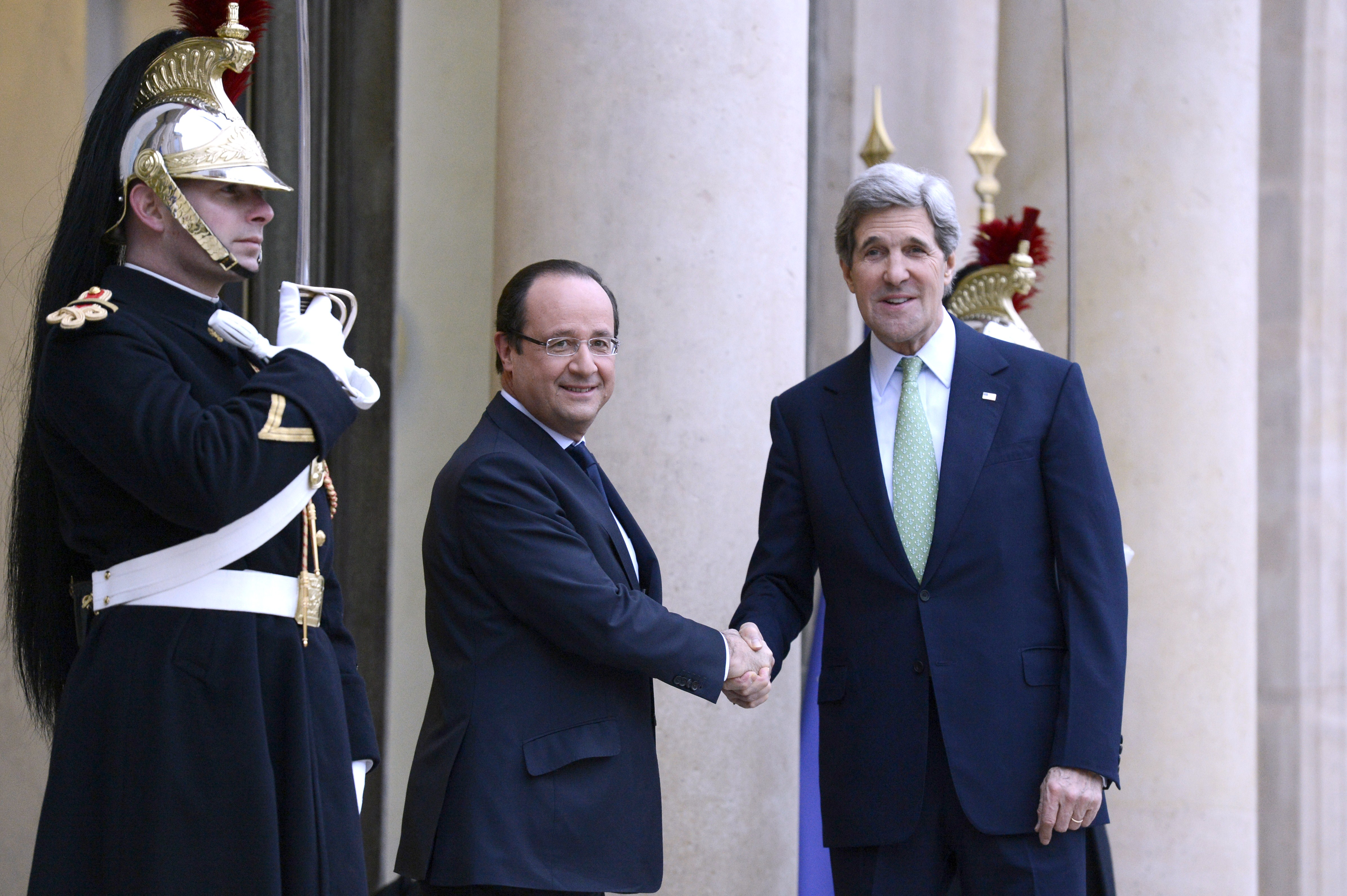 French President Francois Hollande (L) welcomes US Secretary of State John Kerry prior to a meeting at the Elysee presidential Palace, on February 27, 2013, in Paris.