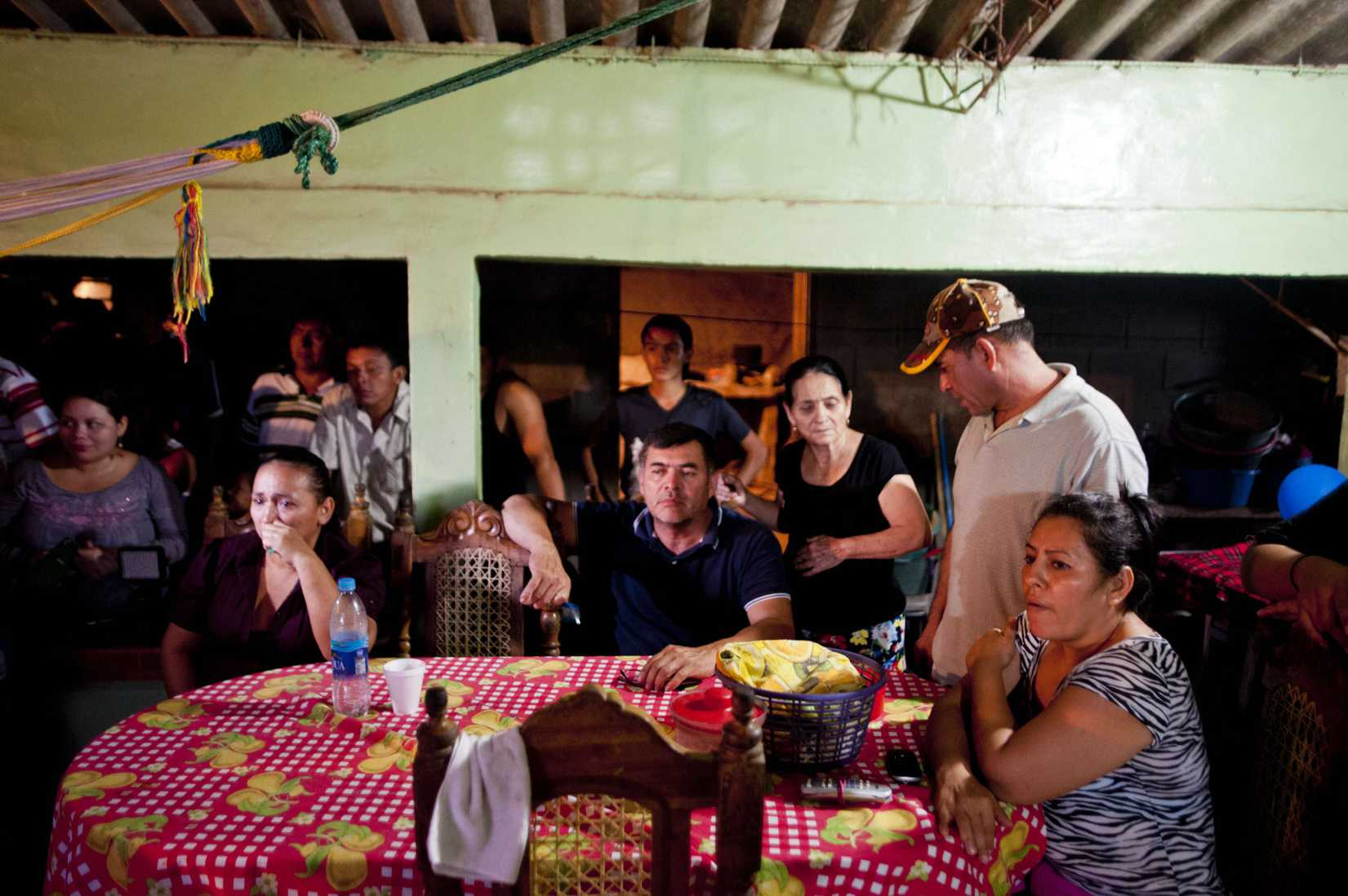 Pacific castaway Jose Salvador Alvarenga's family watch the broadcast of his arrival at their house in Garita Palmera 118 km. west from San Salvador, El Salvador, on February 11, 2014.
