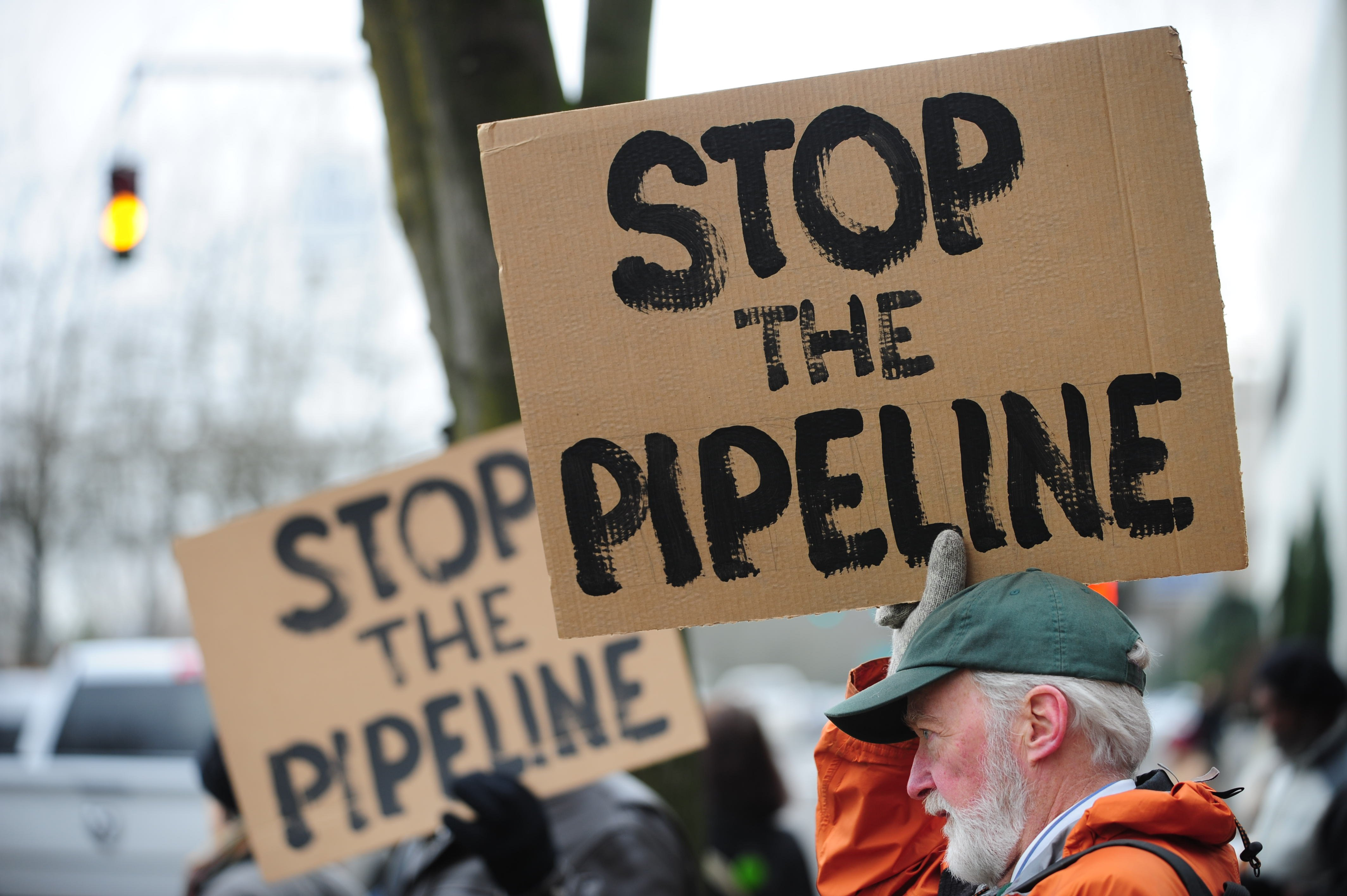 Protesters demonstrate against TransCanada in Portland on the opening day of the southern leg of the Keystone Pipeline, on Jan. 22, 2014.