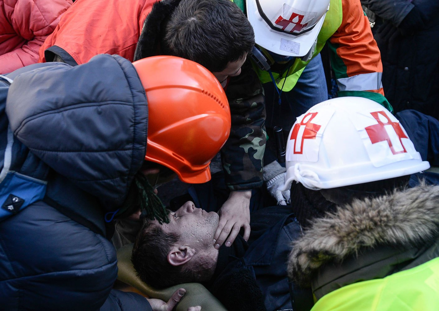 An Interior Ministry member, who was injured during clashes with anti-government protesters, receives medical treatment as he lies on a stretcher in Kiev February 18, 2014.
