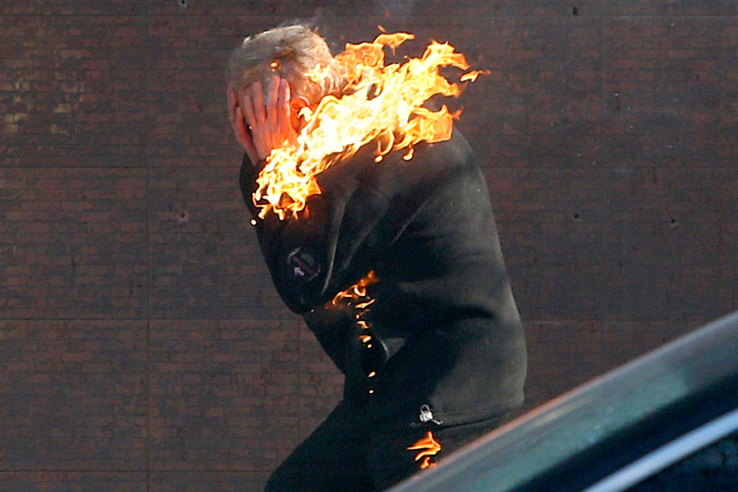 An anti-government protester is engulfed in flames while running from the scene during clashes with riot police outside Ukraine's parliament in Kiev, on Feb. 18, 2014.