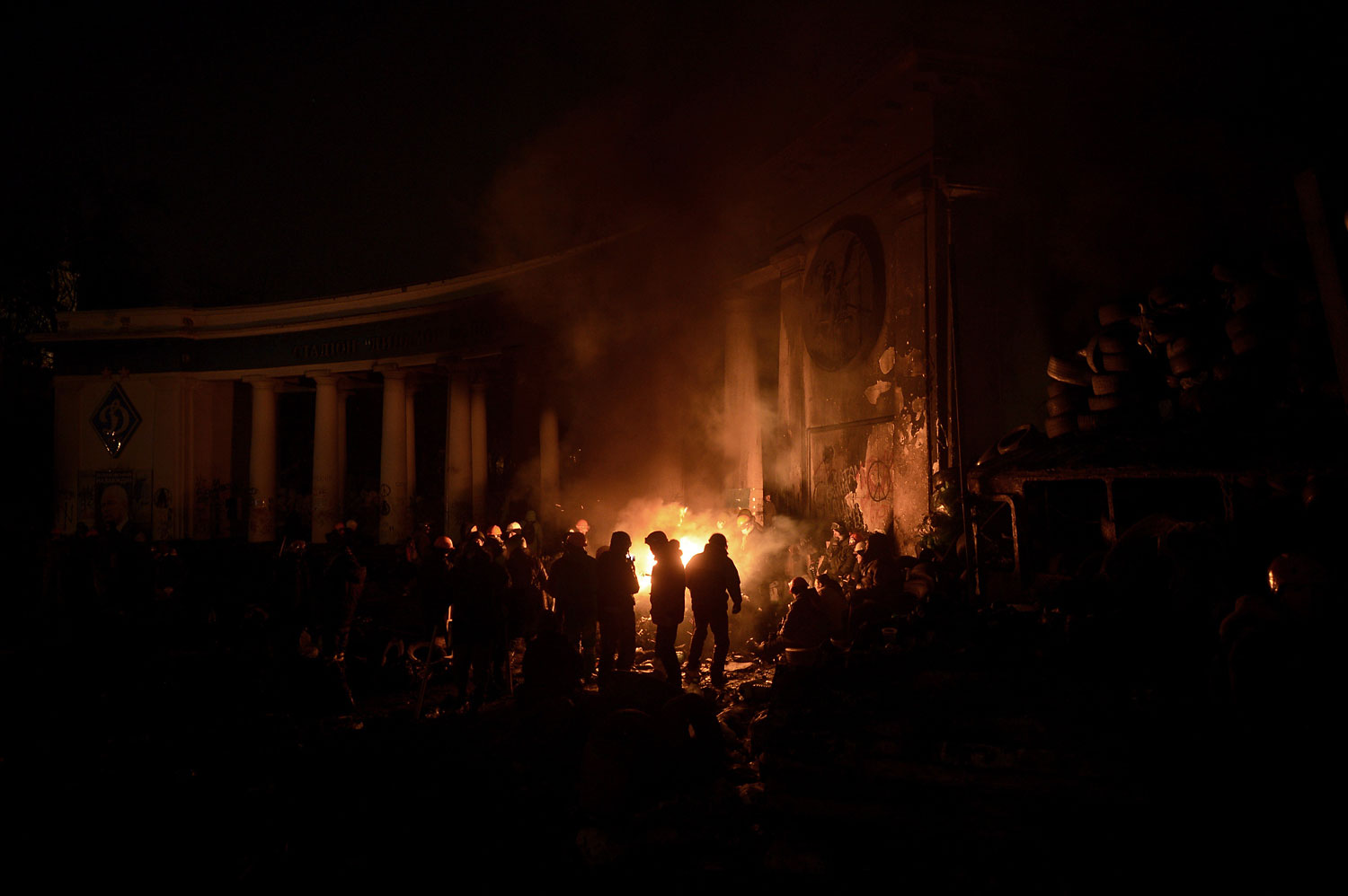 Anti-government protesters gather around a fire to get warm at a road block in Kiev,  Jan. 26, 2014.