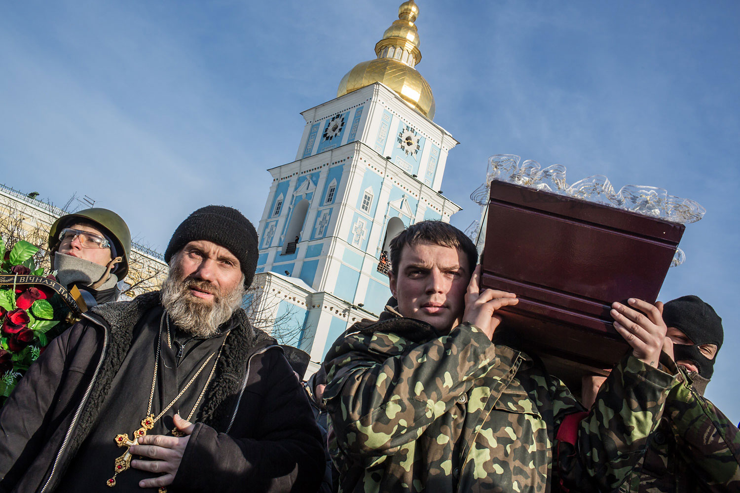 Men carry a casket containing the body of Mikhail Zhiznevsky, 25, an anti-government protester who was killed in clashes with police, outside Mikhailovsky Cathedral after a memorial service there in his honor on Jan. 26, 2014 in Kiev.