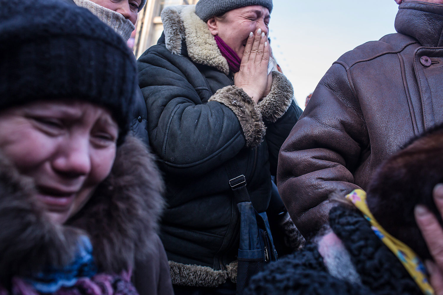 Women weep as a casket containing the body of Mikhail Zhiznevsky, 25, an anti-government protester who was killed in clashes with police, is carried past on Jan. 26, 2014 in Kiev.