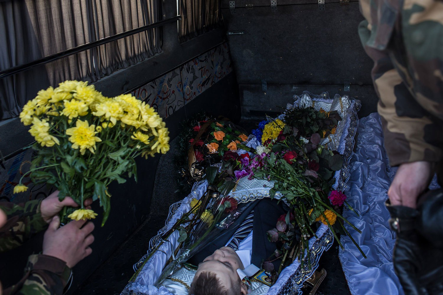 The body of Mikhail Zhiznevsky, 25, an anti-government protester who was killed in clashes with police, rests in the back of a hearse following a memorial service in his honor on Jan. 26, 2014 in Kiev.