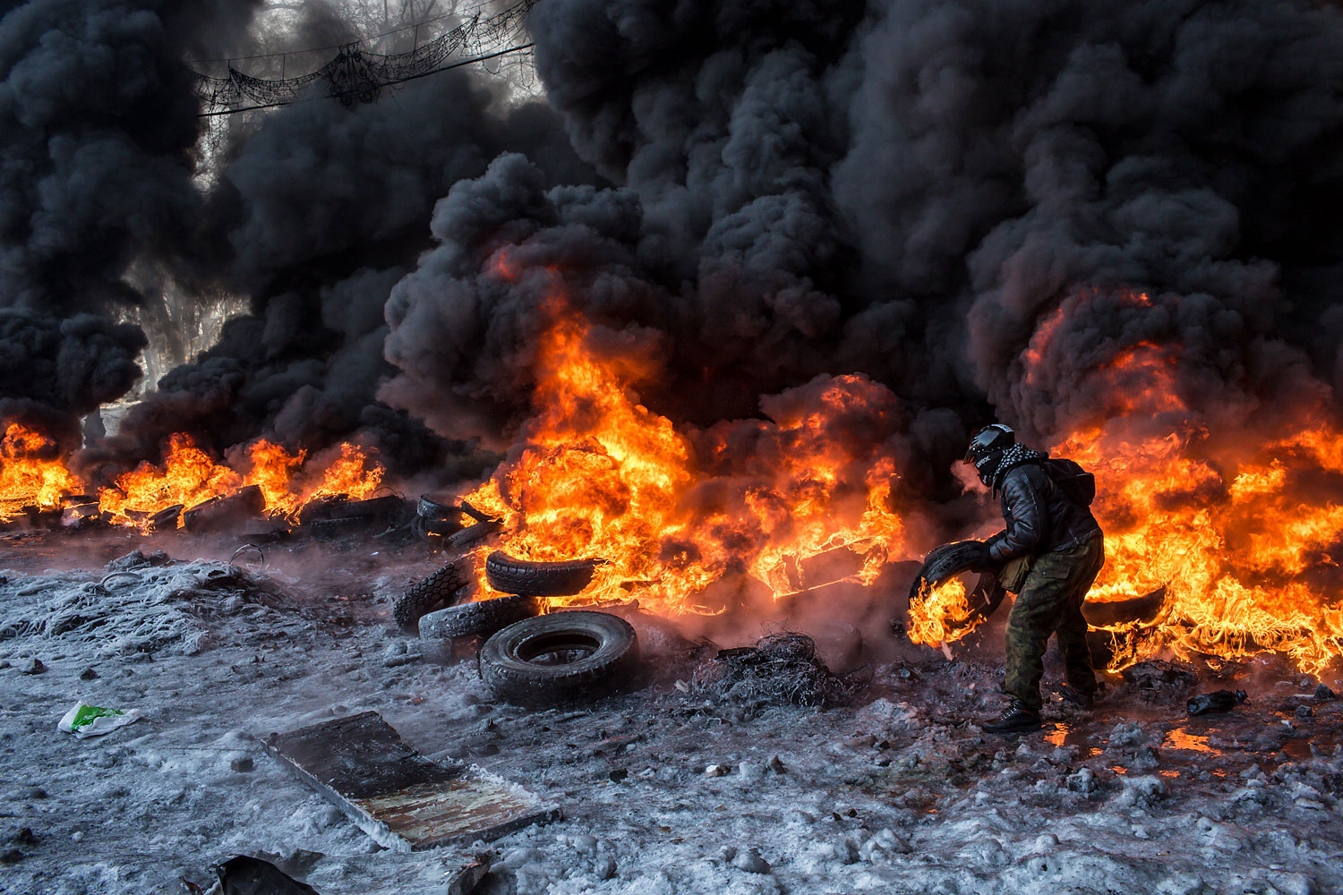 A Ukrainian protester burns tires during clashes with police in Kiev on Jan. 25, 2014