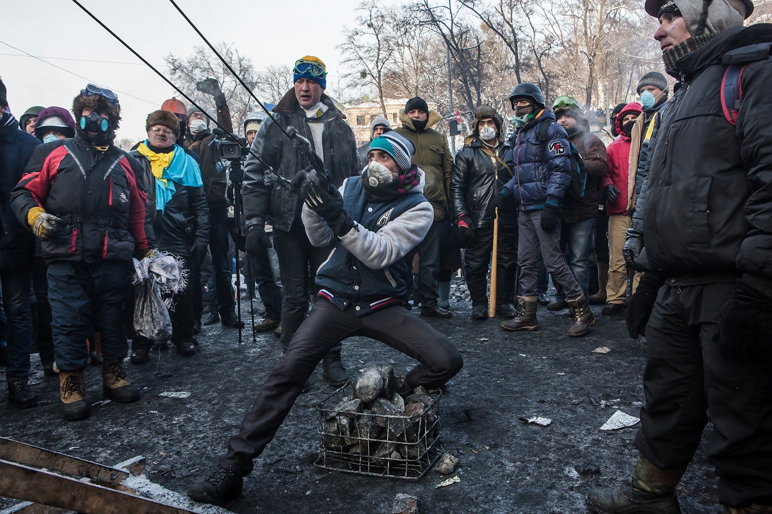 An anti-government protester uses a large sling shot during clashes with police on Hrushevskoho Street near Dynamo stadium on Jan. 25, 2014 in Kiev.