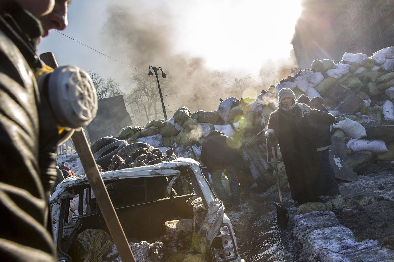 Anti-government protestors clear a channel through barricades near Dynamo Stadium on Jan. 24, 2014 in Kiev.